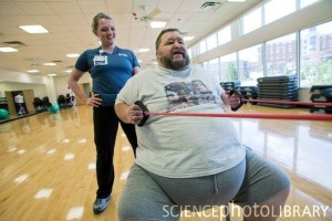 Obese man exercising. Overweight retired school bus driver in an exercise class at a health and fitness centre near his home in Knoxville, Tennessee, USA. From the book 'What I Eat: Around the World in 80 Diets' by Peter Menzel and Faith D'Aluisio.