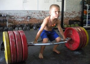 little-kid-lifting-trap-bar-deadlift